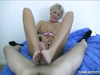 Mature sure likes pleasing the young man with footjob