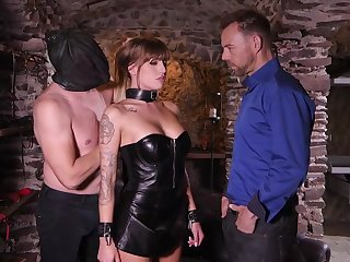 Great looking babe in a leather corset and skirt, Silvia Dellai had sex with two horny guys