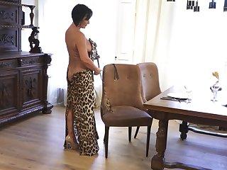 Mature lady makes leopard print dress look sexy and she masturbates a lot