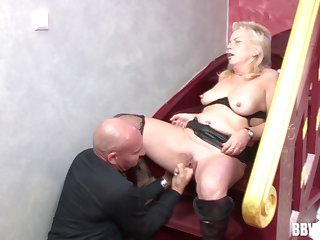 Wild fucking on the stairs between an old bald dude and a mature slut
