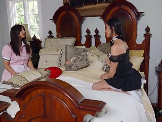 Lesbian sex between housemaids Emily Willis and Tru Kait on the bed