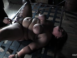 Super fat whore Karla Lane is punished in the dark BDSM room